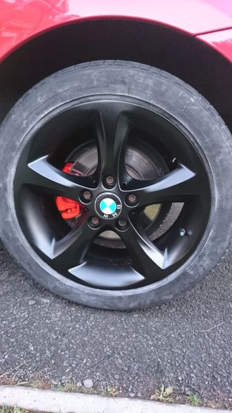 Satin black wheels and red calipers on a BMW 1 series in Forest Town, Mansfield: Swipe To View More Images